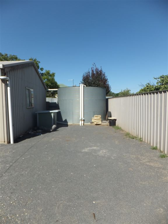 Rainwater tank at rear of garage/workshop/extra living area