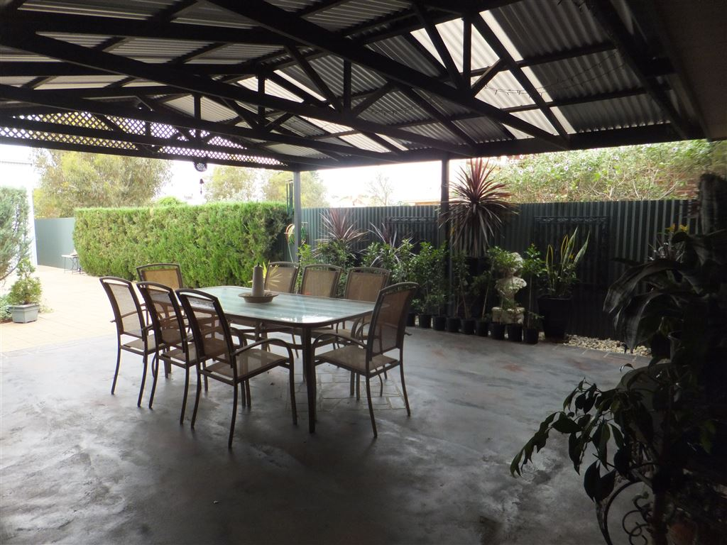 Outdoor entertaining & dining area; fully weatherproof with access to kitchen & living area of house