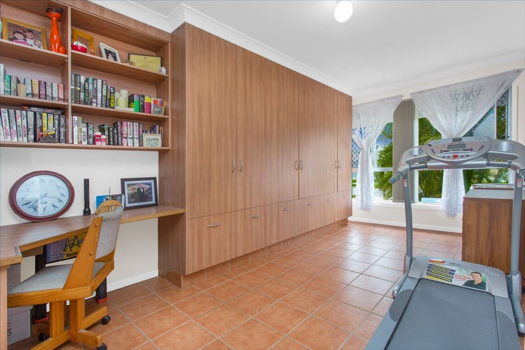 Tiled Rumpus / Family room - Builtin cupboards and study desk