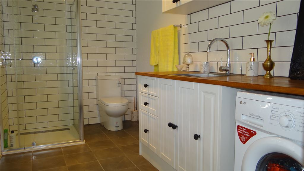 Renovated laundry and second bathroom