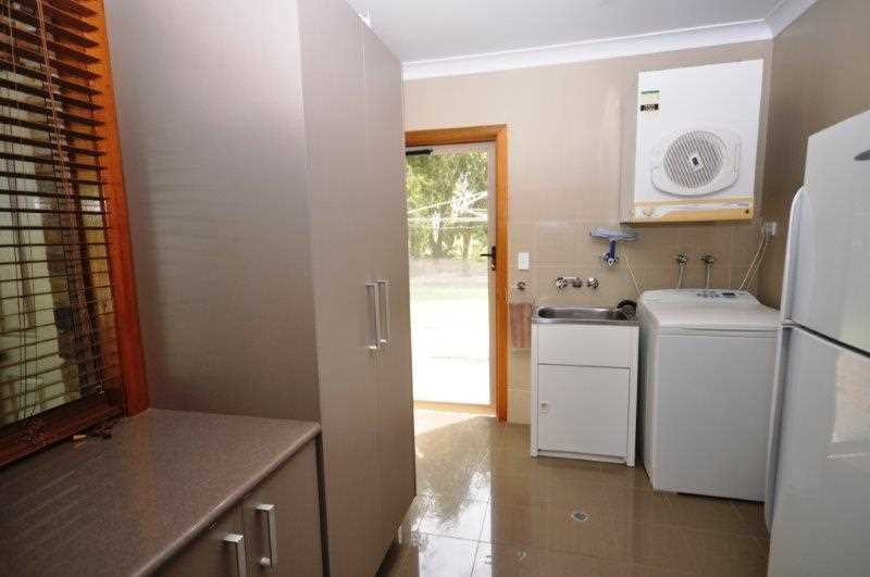 Laundry, line space out the door, entertaining area to the left, bathroom to the right