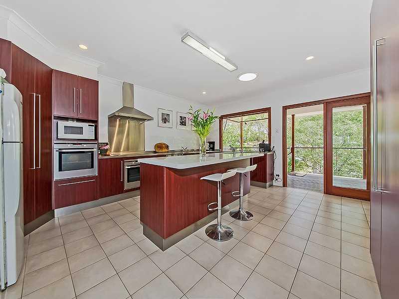 Stunning modern kitchen opening onto rear deck