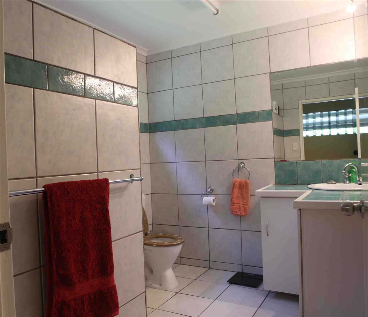 Inside view of part of home showing part of the bathroom