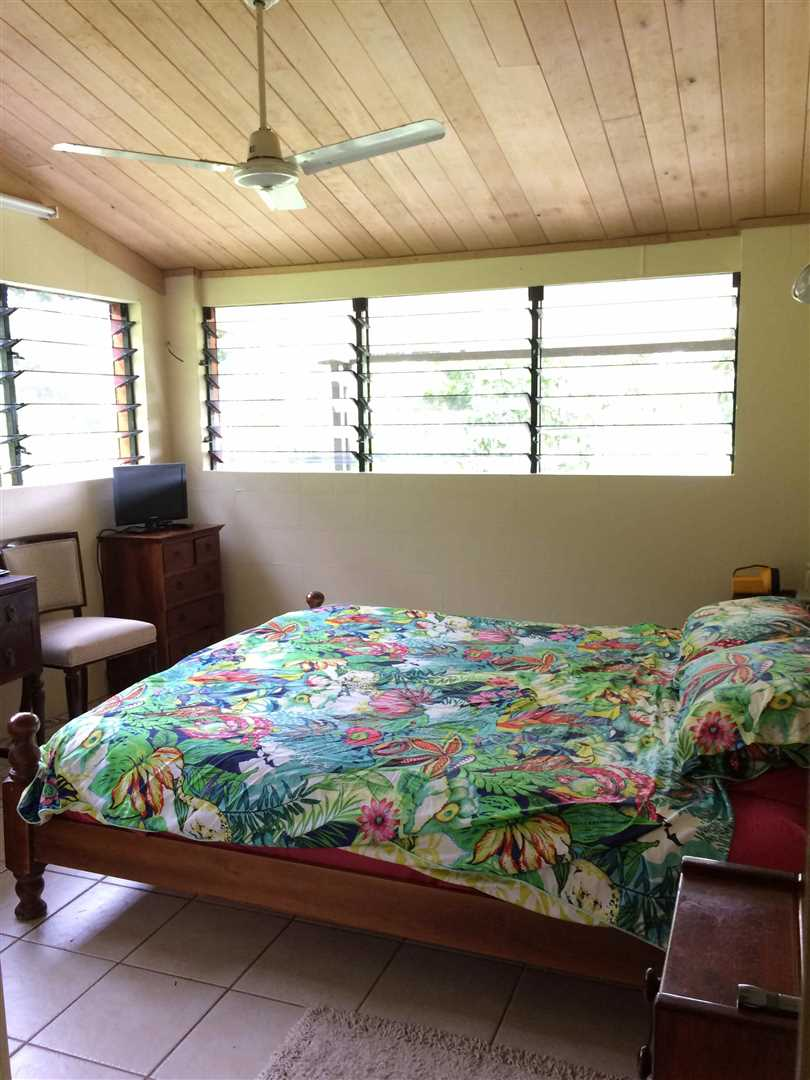 Inside view of part of home showing part of the first bedroom