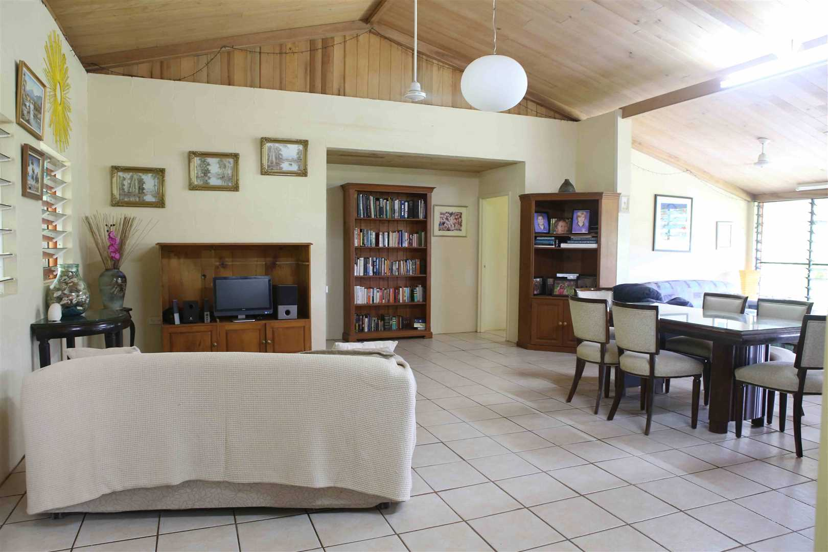 Inside view of part of home showing part of the open plan living and dining areas, photo 1