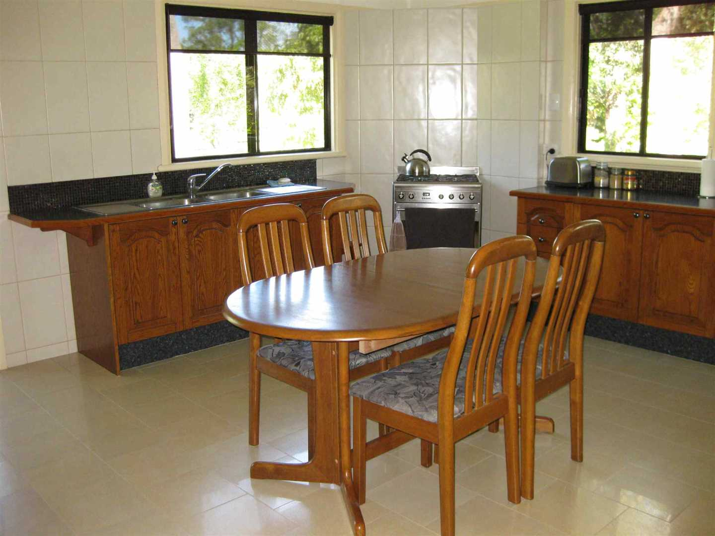 Inside view of part of home showing part of dining area and kitchen, photo 1