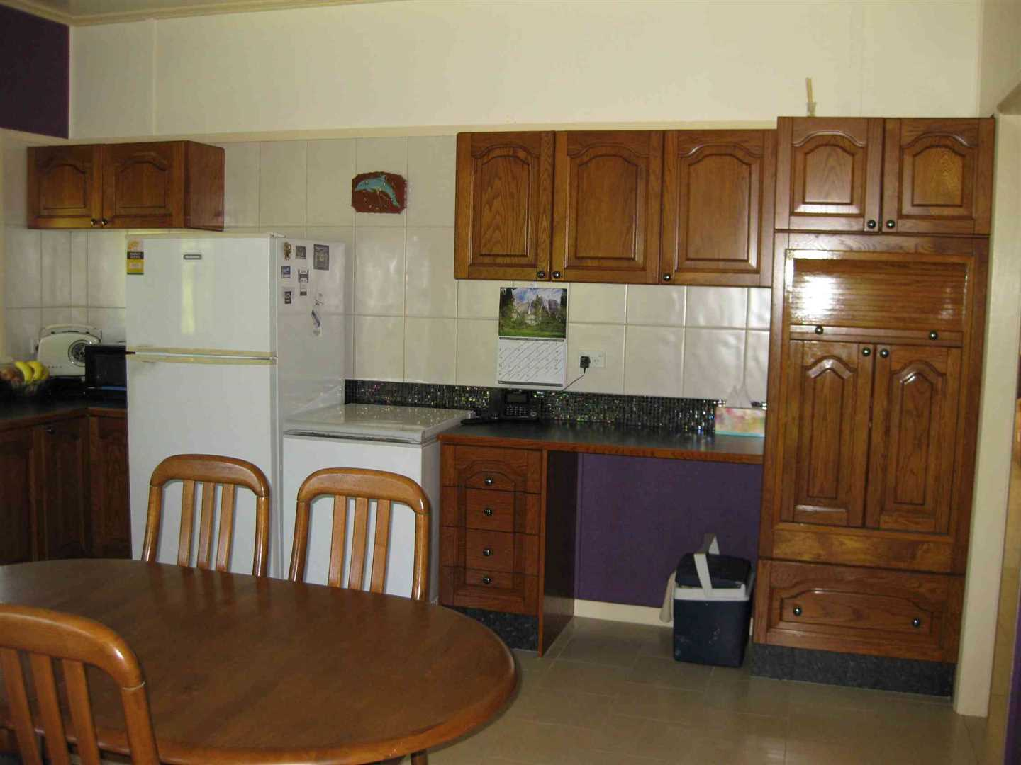 Inside view of part of home showing part of dining area and kitchen, photo 2