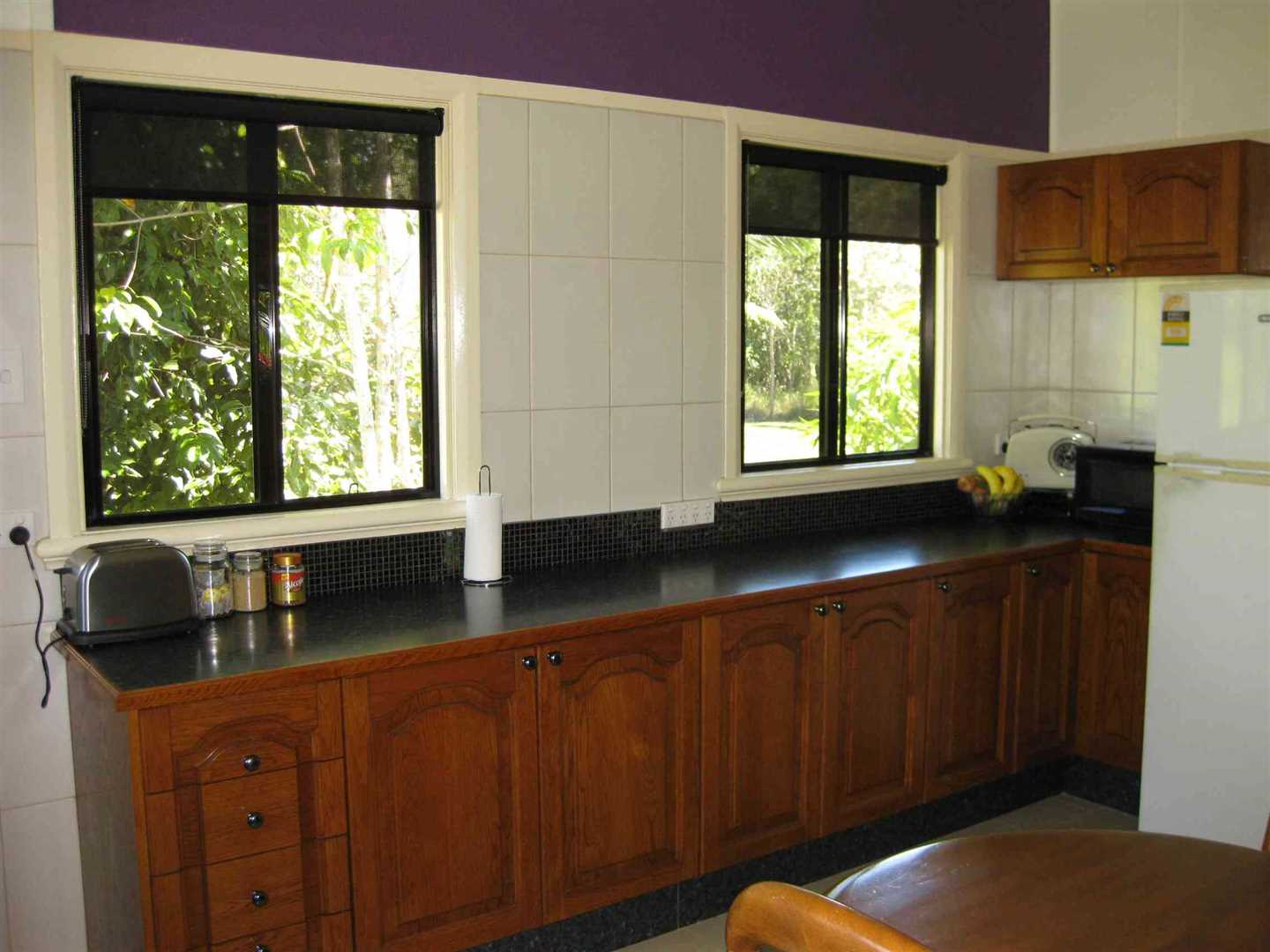 Inside view of part of home showing part of dining area and kitchen, photo 3