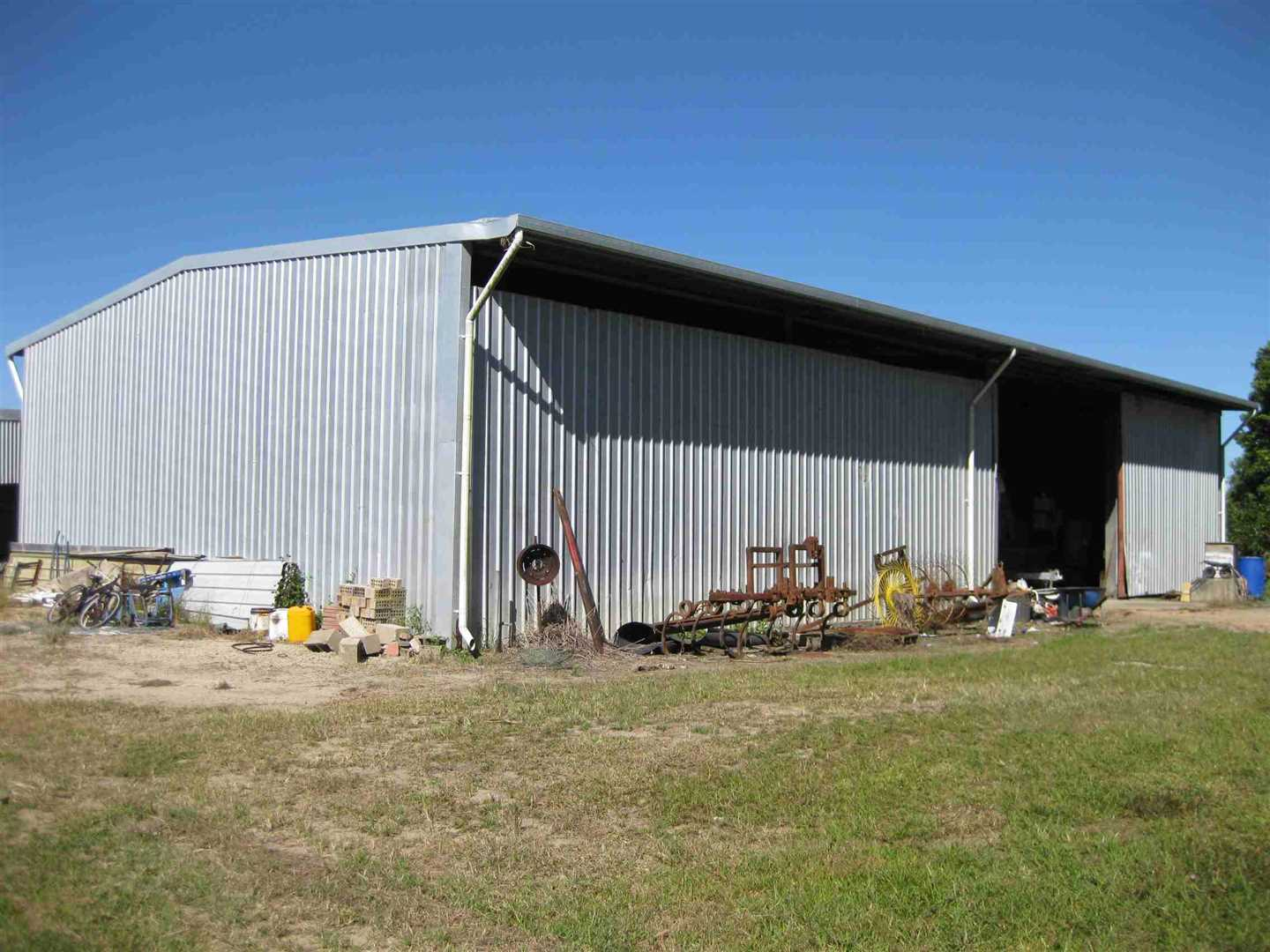 View of part of large farm shed, photo 4