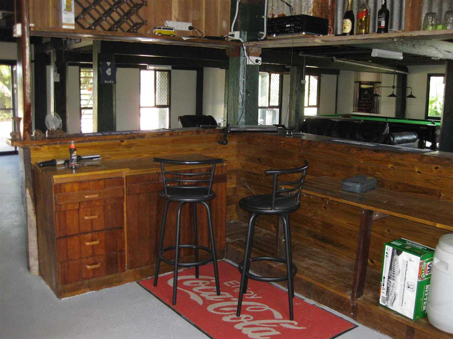 Inside view of part of home showing part of ground floor entertainment room and timber bar area