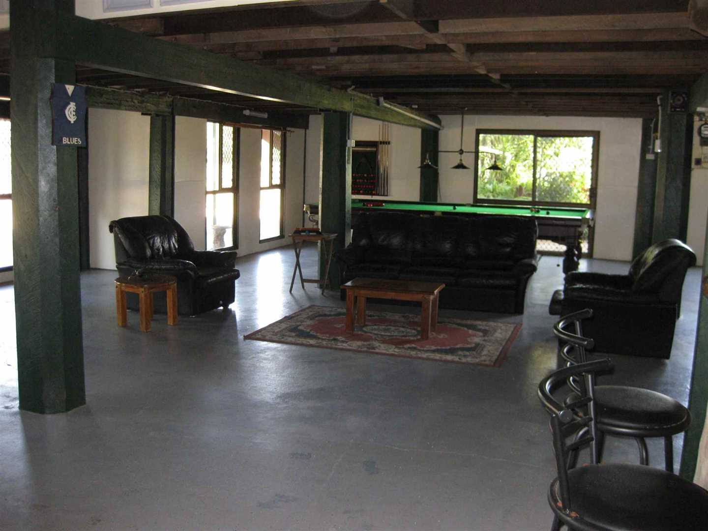Inside view of part of home showing part of ground floor entertainment room, photo 1