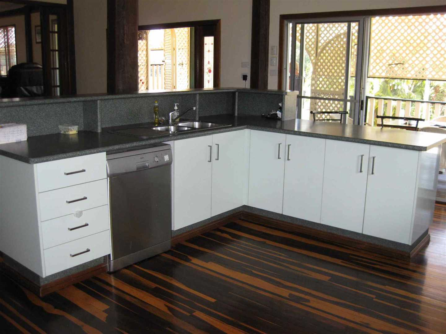 Inside view of part of home showing part of kitchen, photo 1