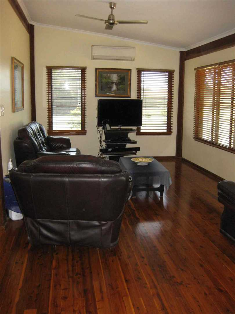 Inside view of part of home showing part of lounge, photo 1