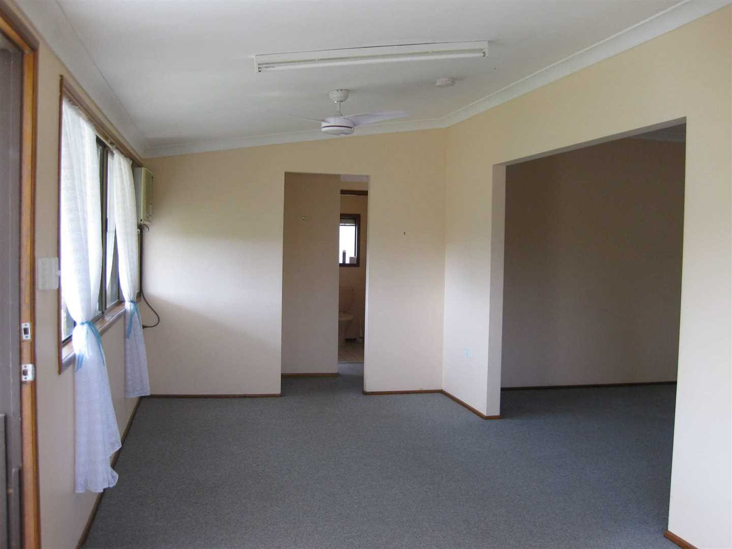 Inside view of part of home showing part of formal dining area and part of lounge to the right