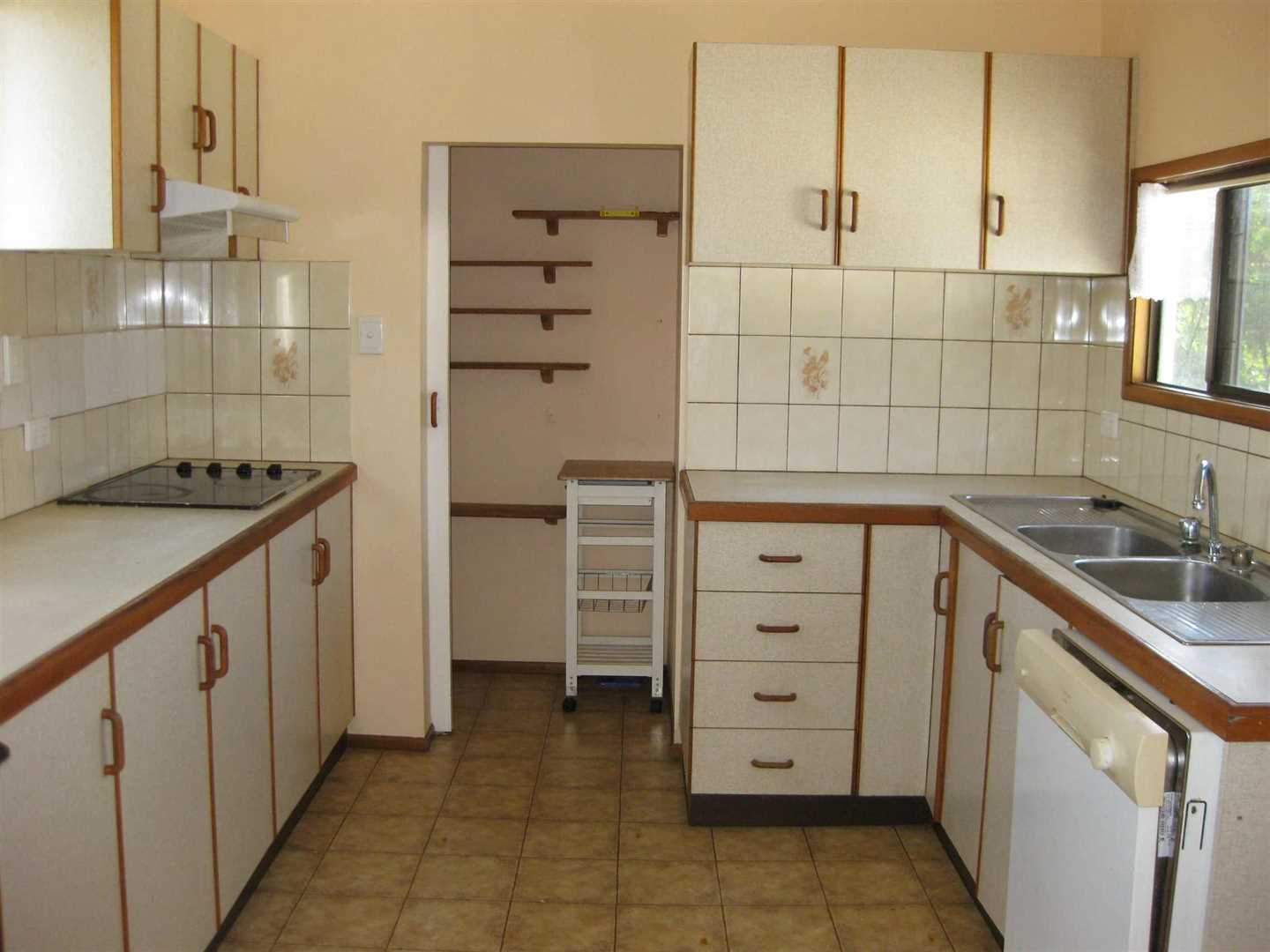 Inside view of part of home showing part of kitchen