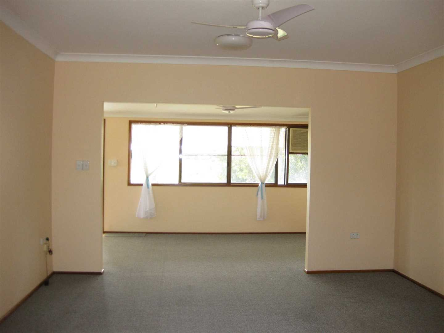 Inside view of part of home showing part of lounge and part of formal dining area behind