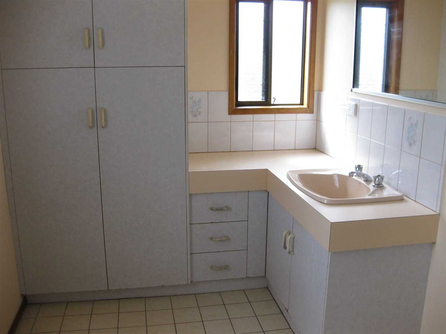 Inside view of part of home showing part of bathroom, photo 1