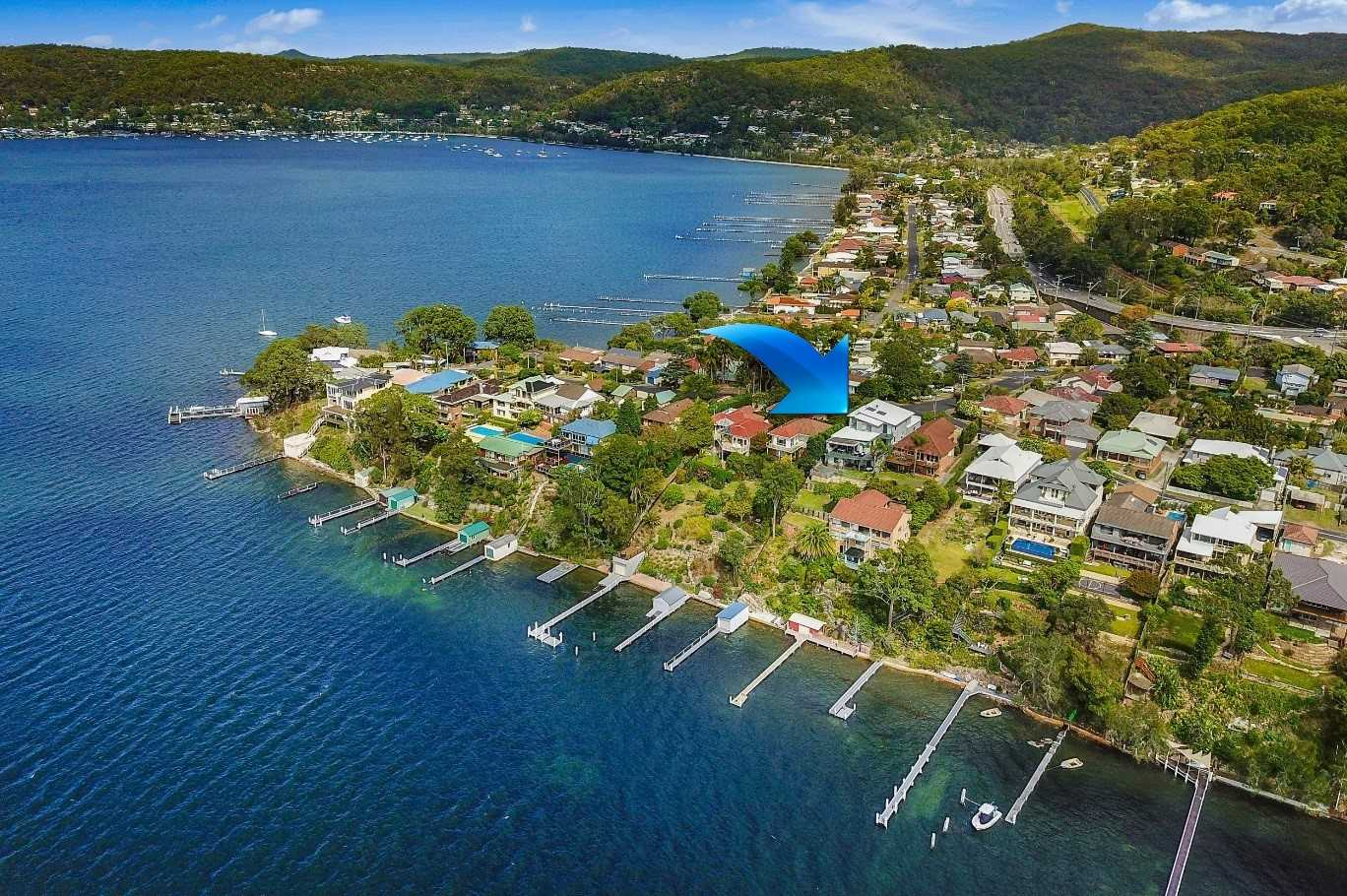 Aerial view property, private jetty, boat-house