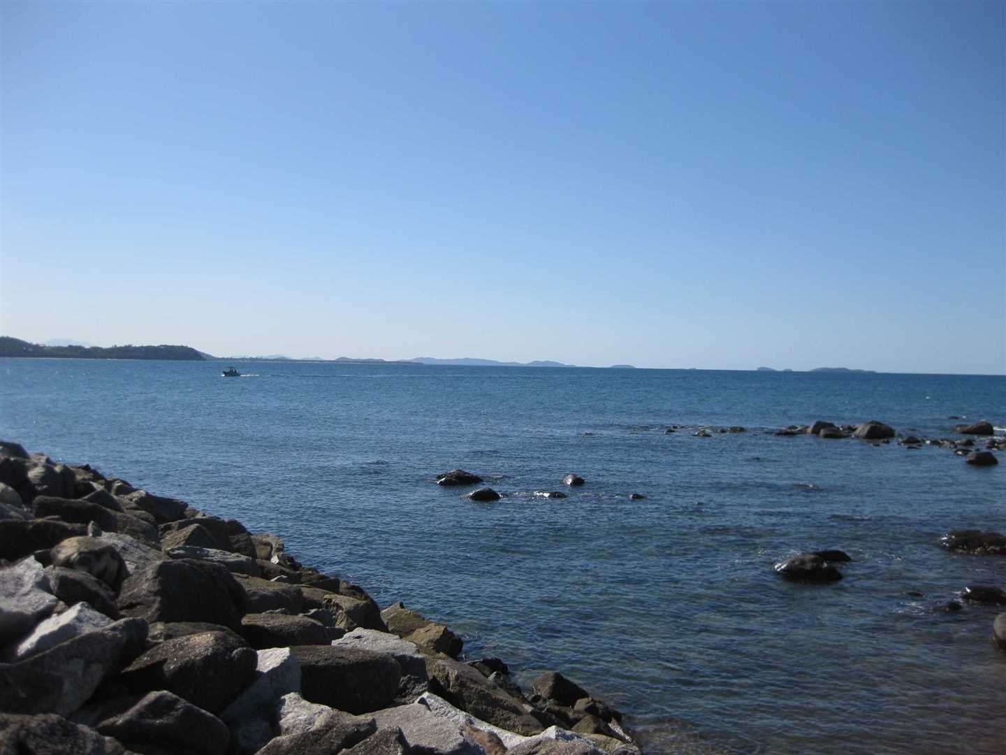 View from adjacent to Clump Point public boat ramp with part of breakwater to the left and some distant Islands to the North