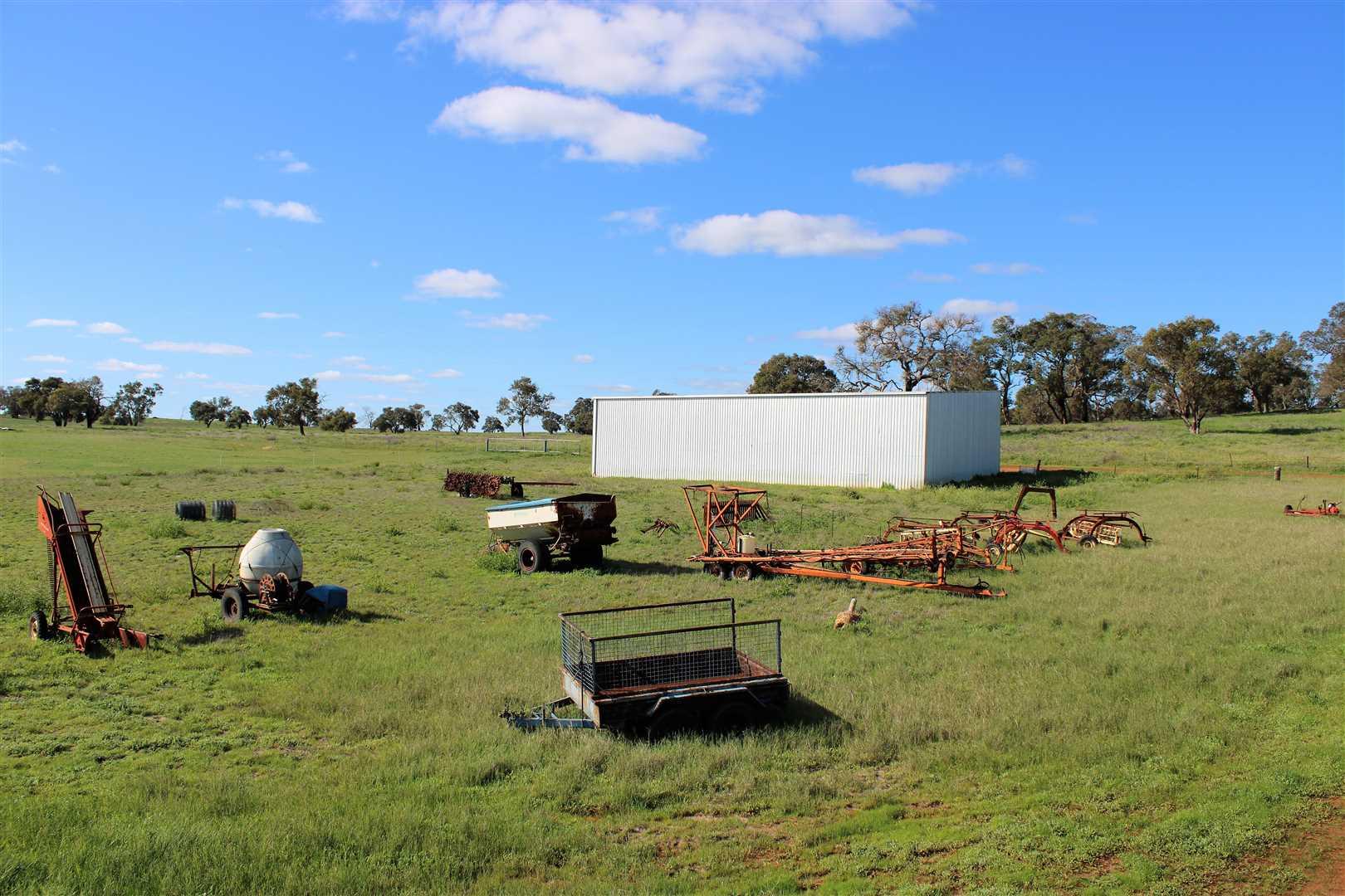 Behind hay shed