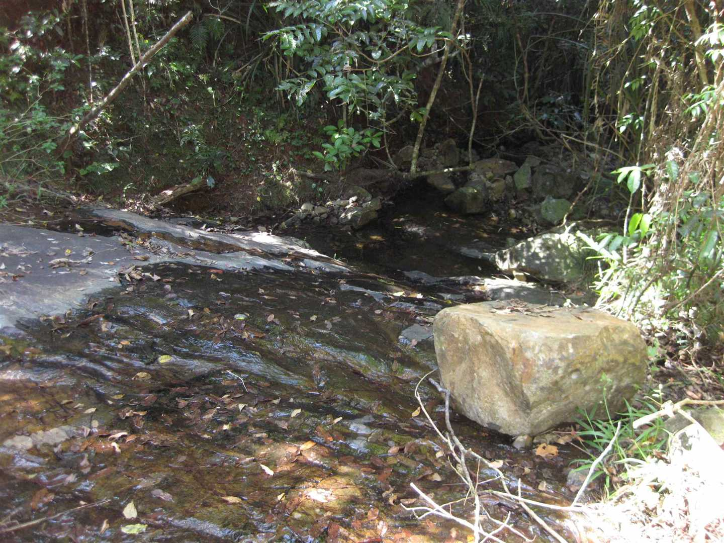 View of part of small seasonal waterfall area adjacent to the property in the adjoining National Park, photo 2