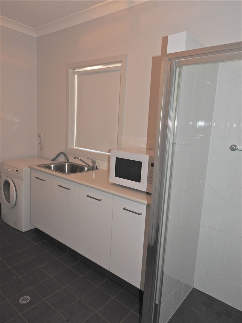 Downstairs Laundry and Shower Room