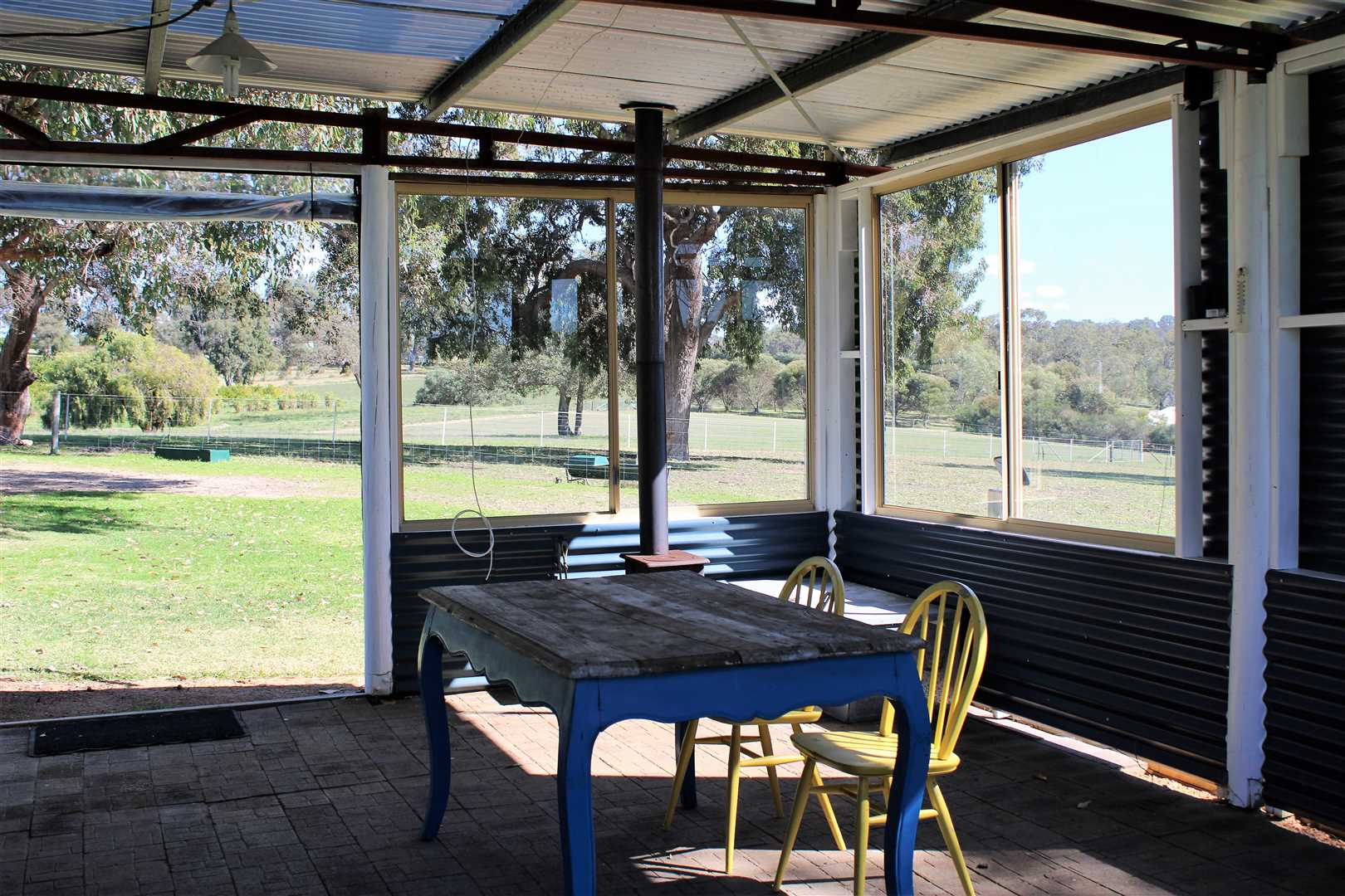 Inside view of the patio area which includes a pot belly stove.