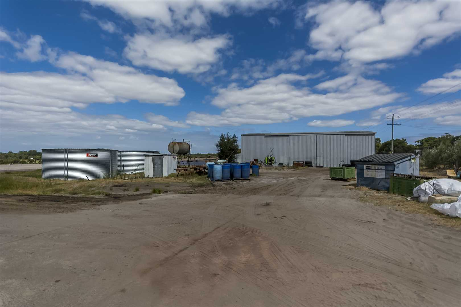 Hardstand, water storage tanks, 240m2 machinery shed