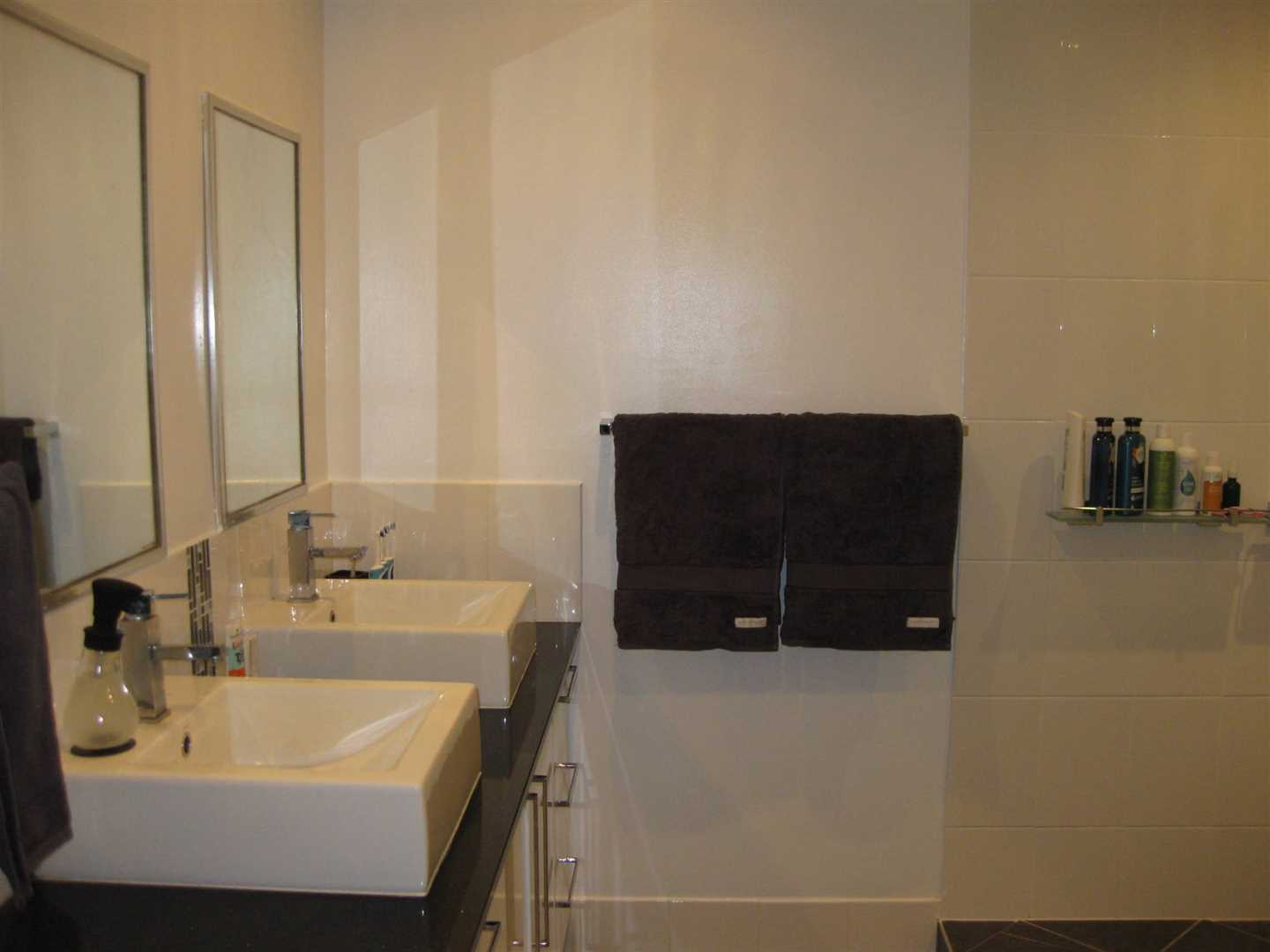 Inside view of part of home showing part of bathroom, photo 2