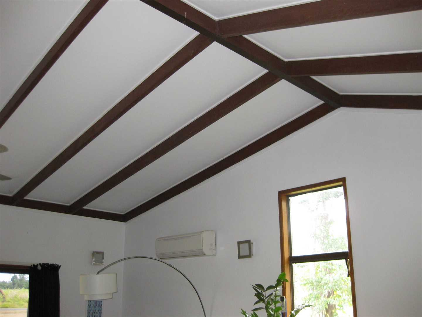 Inside view of part of home showing part of high ceiling