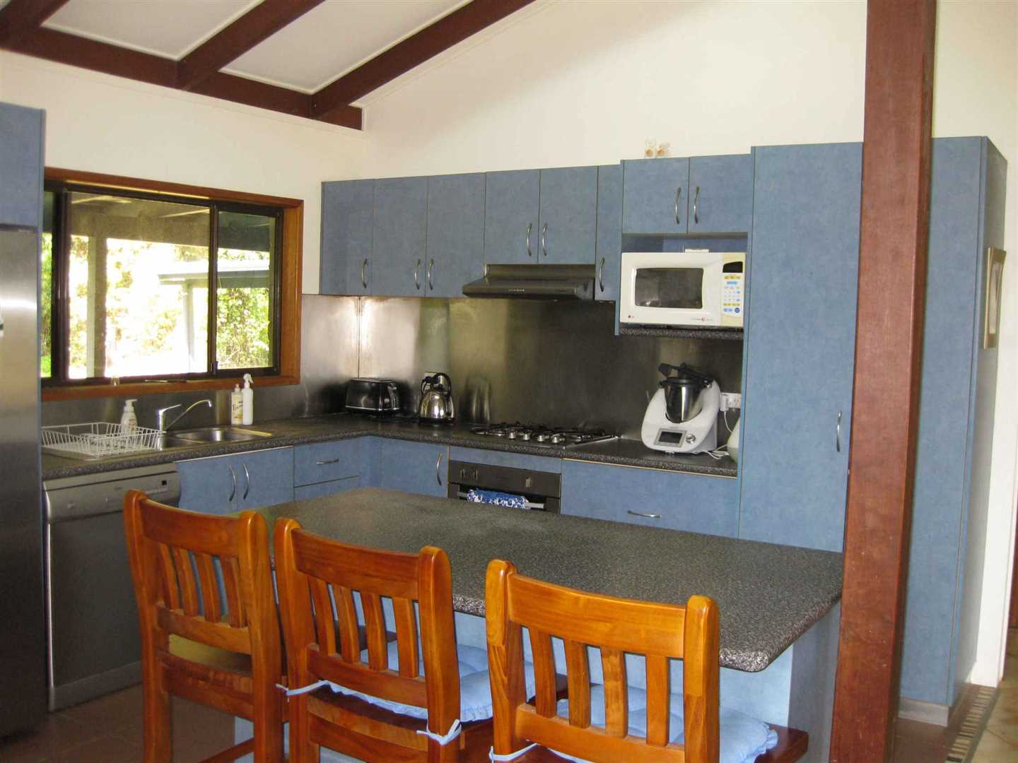 Inside view of part of home showing part of kitchen, photo 2