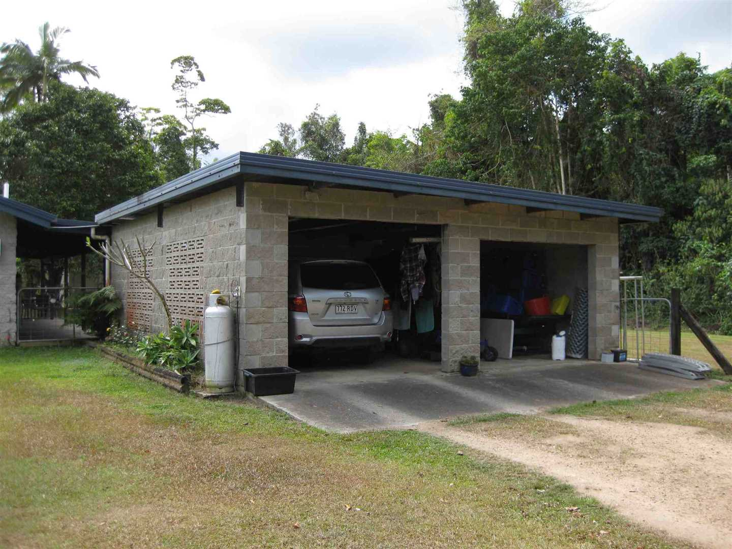 View of part of 2 bay shed or carport adjacent to the home