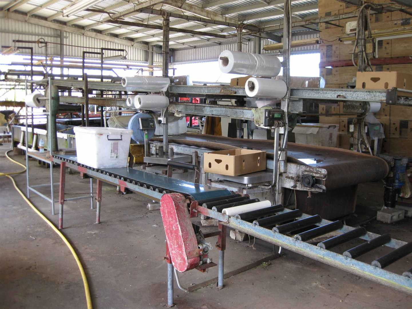 View of part of inside packing shed showing some packing shed items including part of banana trough