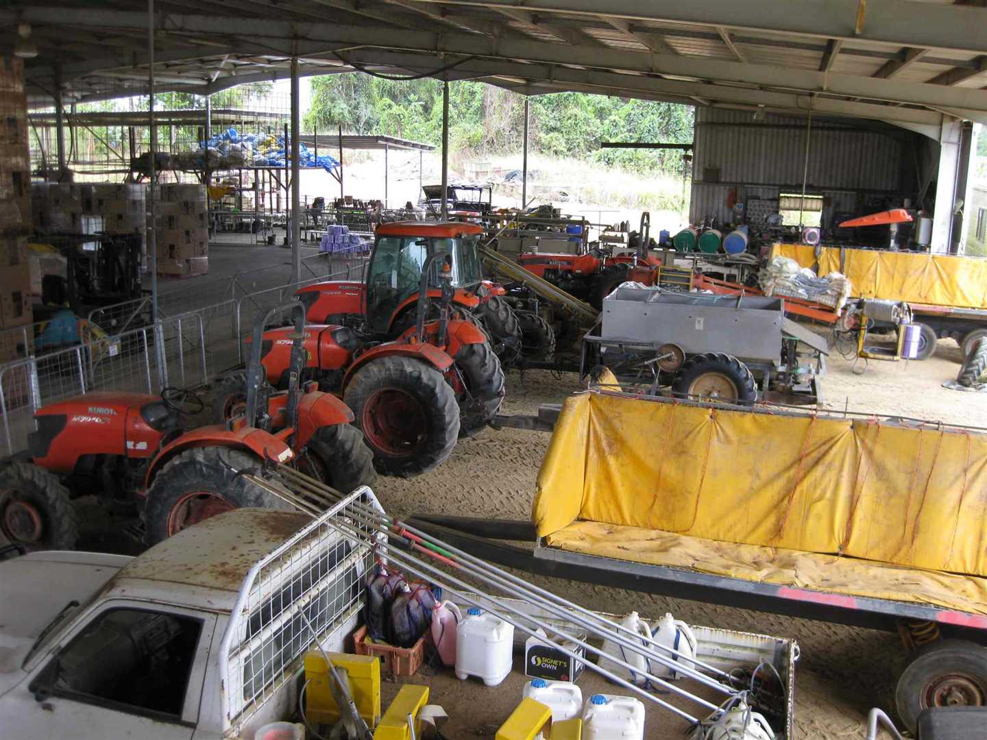 View of part of inside packing shed showing part of machinery storage area