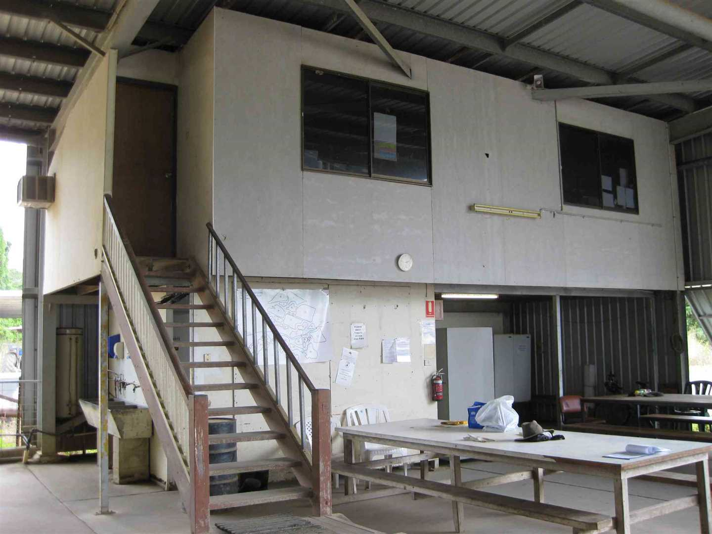 View of part of inside packing shed showing part of upstairs office and downstairs workers eating area