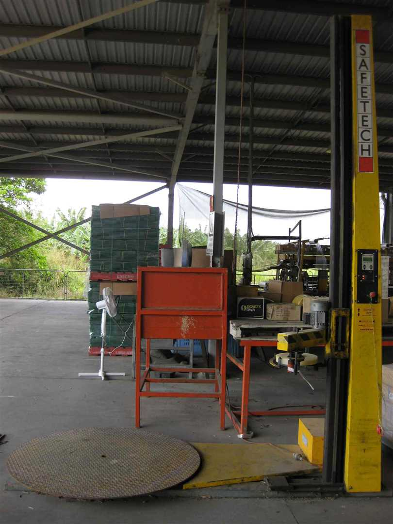 View of part of inside packing shed showing some packing shed items including part of banana wrapper
