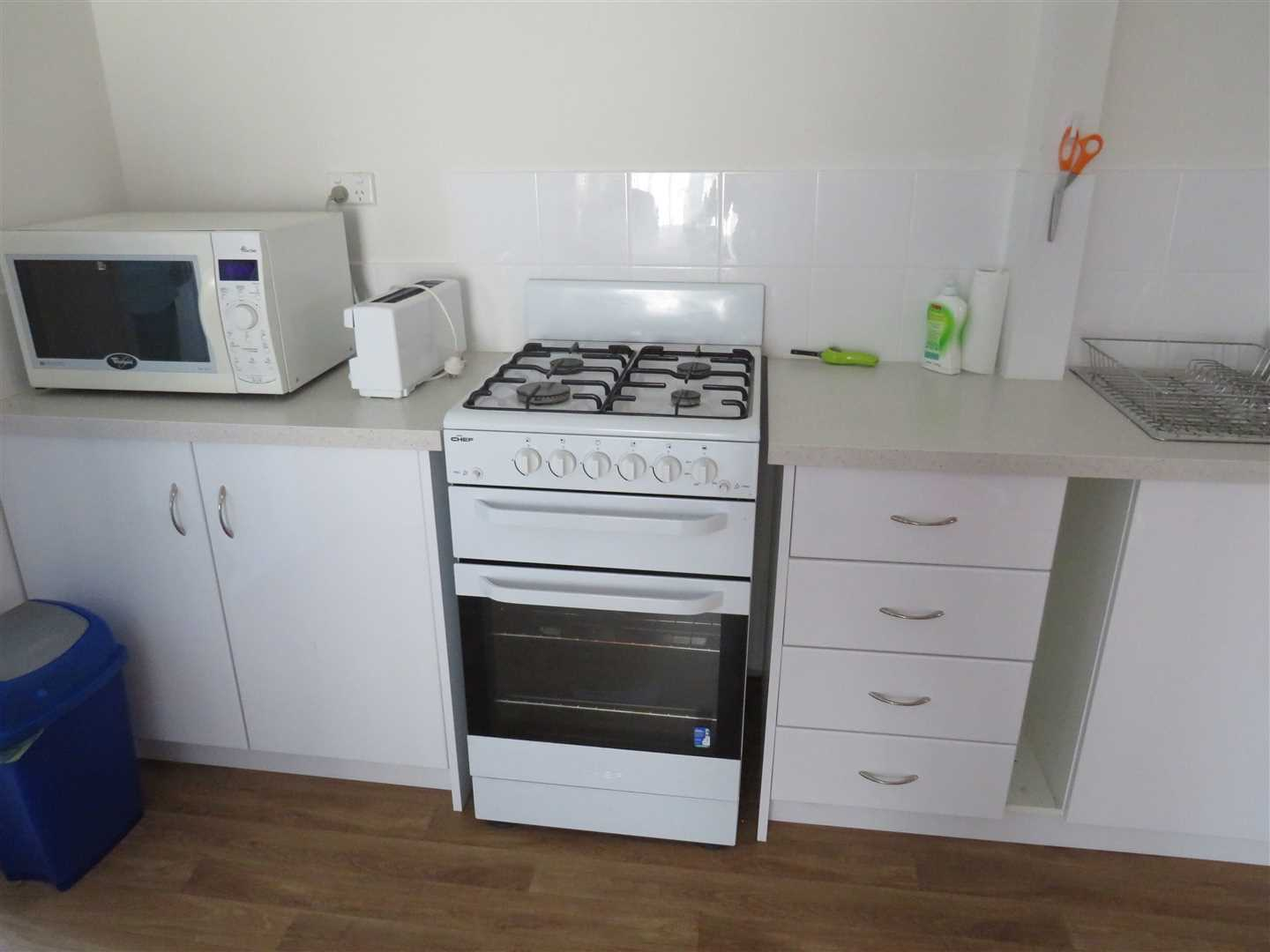 gas stove and microwave in shed unit