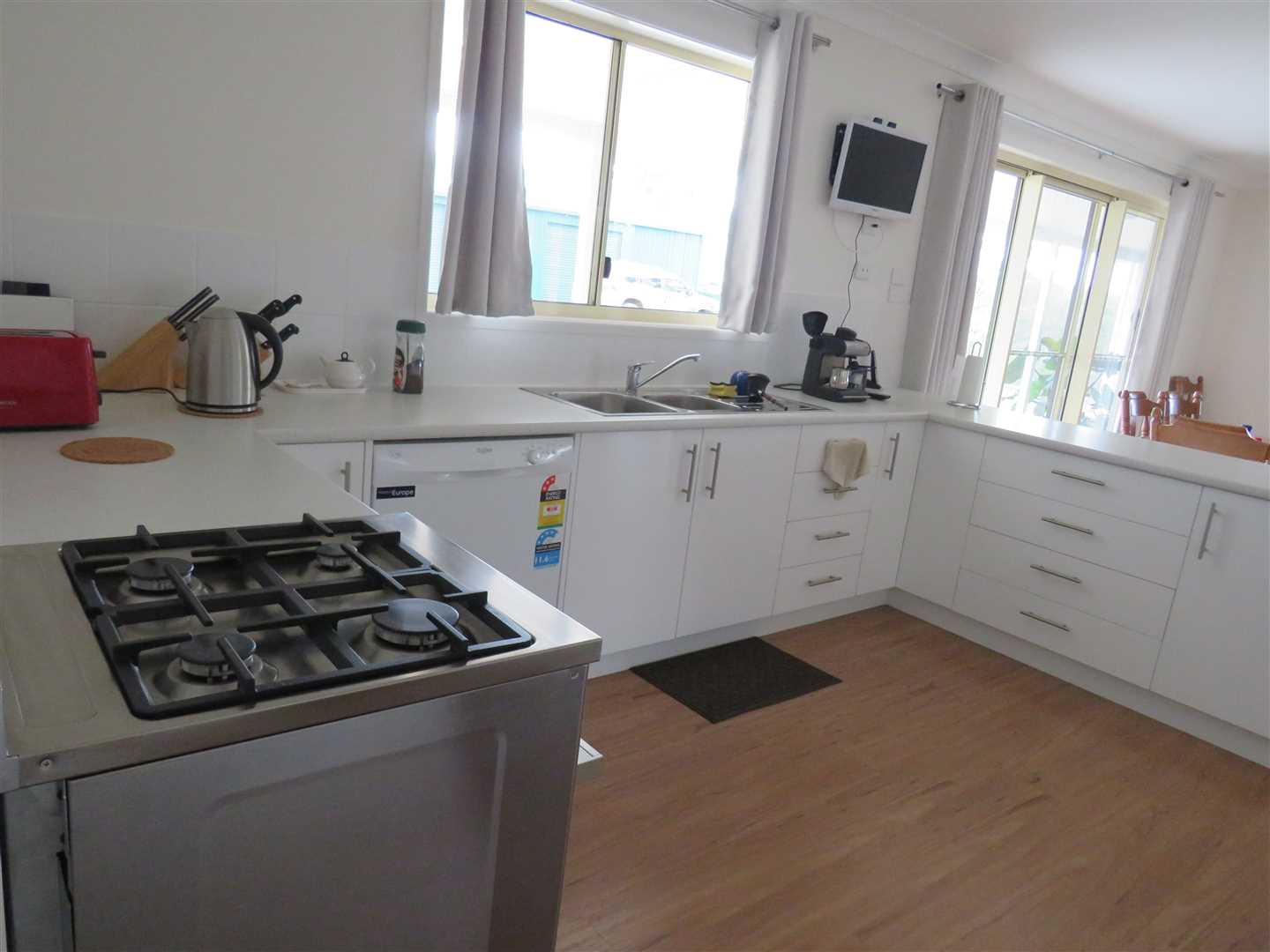 Free standing gas stove with electric grill and gas oven/cooktop,