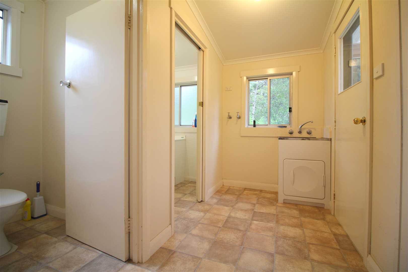 Laundry/Toilet/Bathroom/Exit To Back Of Property