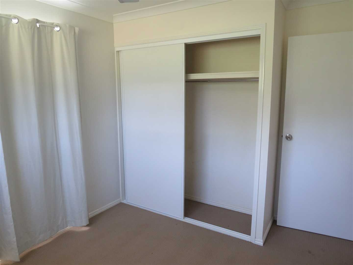 Built in cupboard and fans to rooms 2 and 3.Carpeted