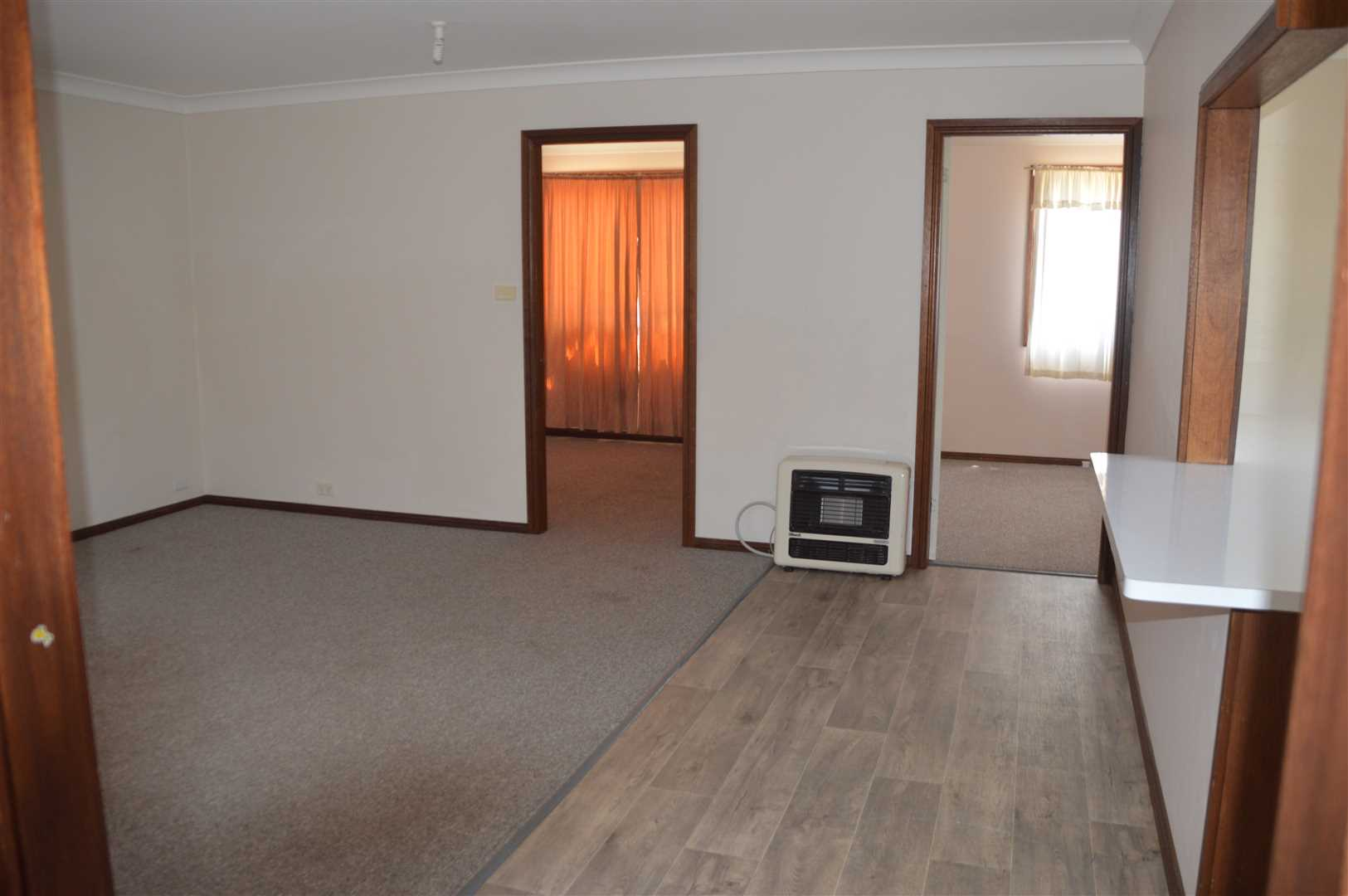 Unit 1 showing entrance to 2 bedrooms off living area