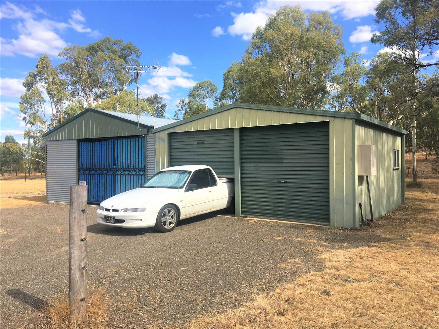 Acre block with double lock up garage, shed, power, water.