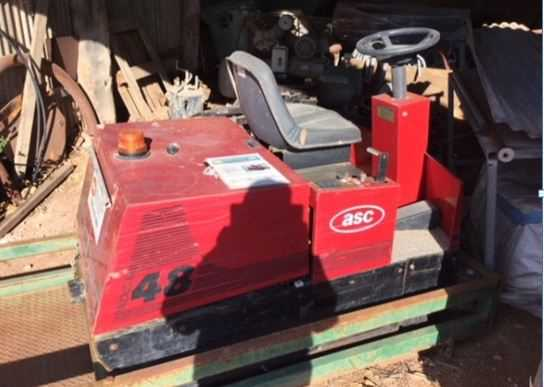 Factory Cat Ride on sweeper & Transport base Ok Condition