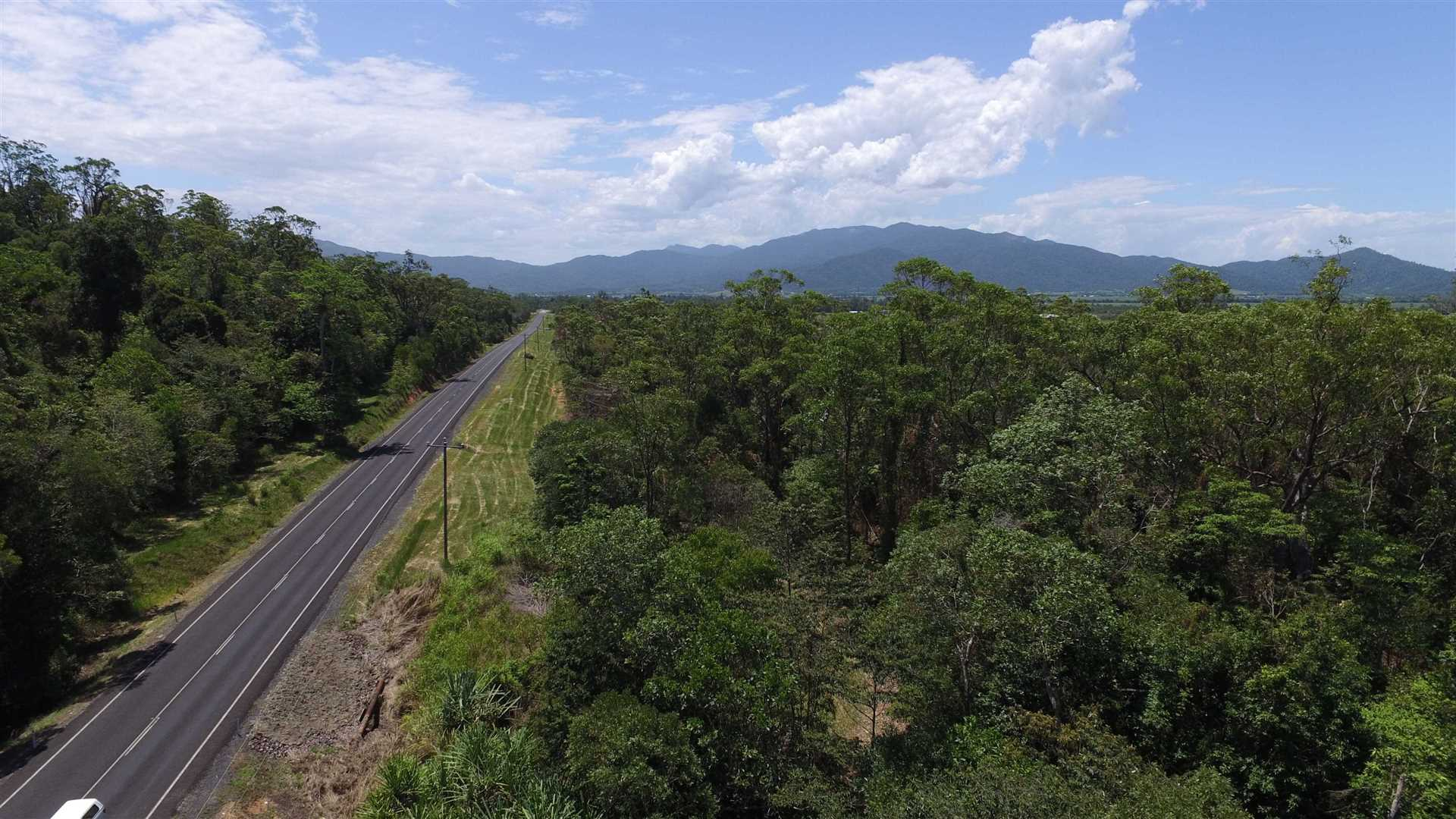 Aerial photo looking approx. West showing part of Lot 70 to right of road and part of Mount Mackay National Park to left of road