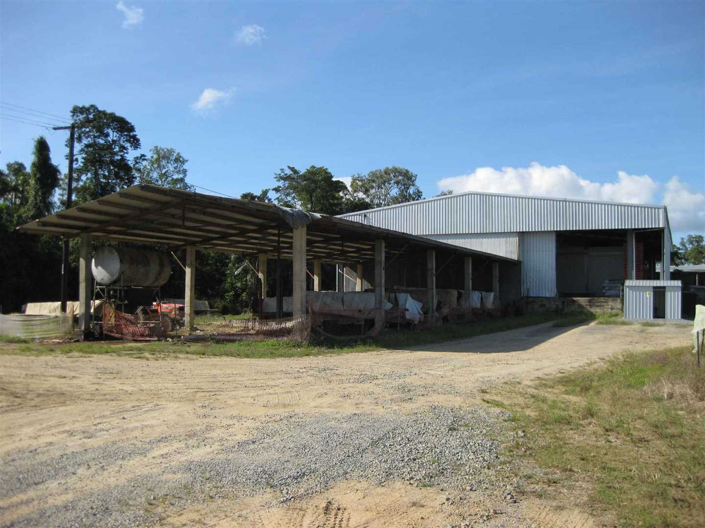 Outside view of part of packing shed, photo 2 with 4 bay machinery shed in front