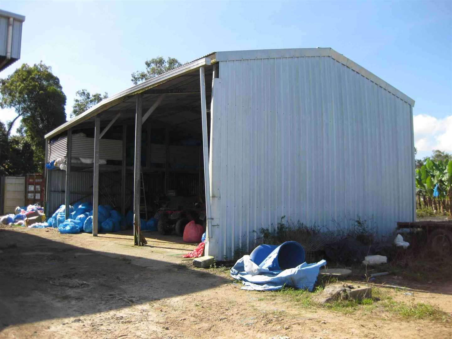 View of part of 4 bay shed with concrete floor and loft