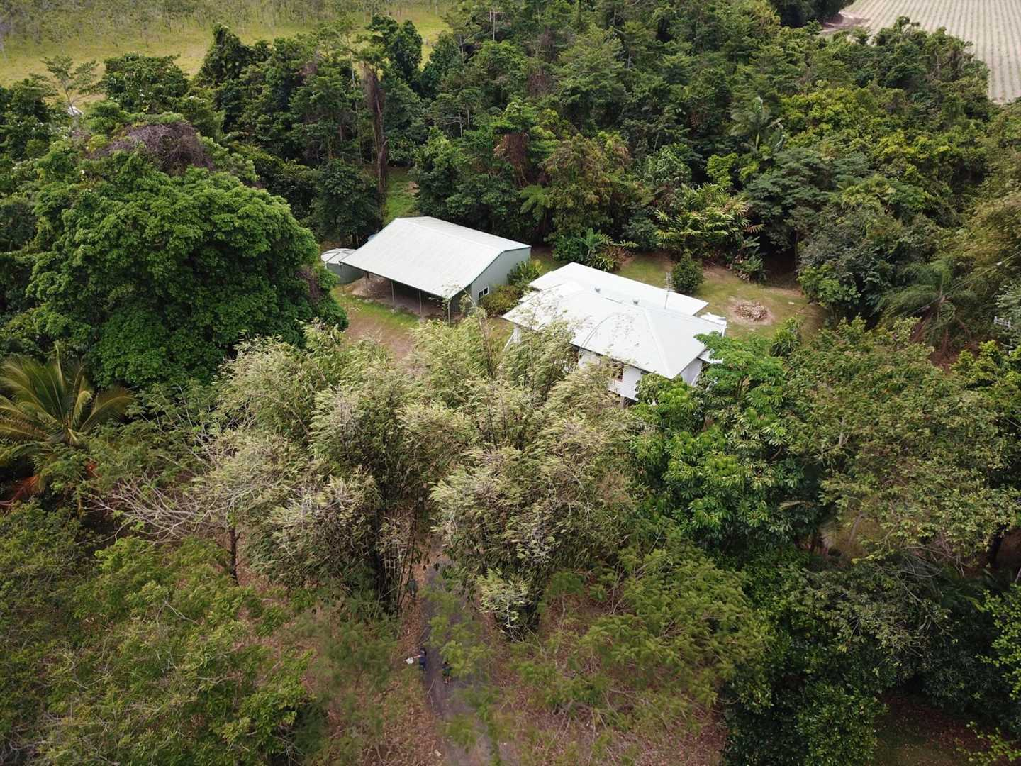 Aerial photo showing part of the property entrance, home and shed