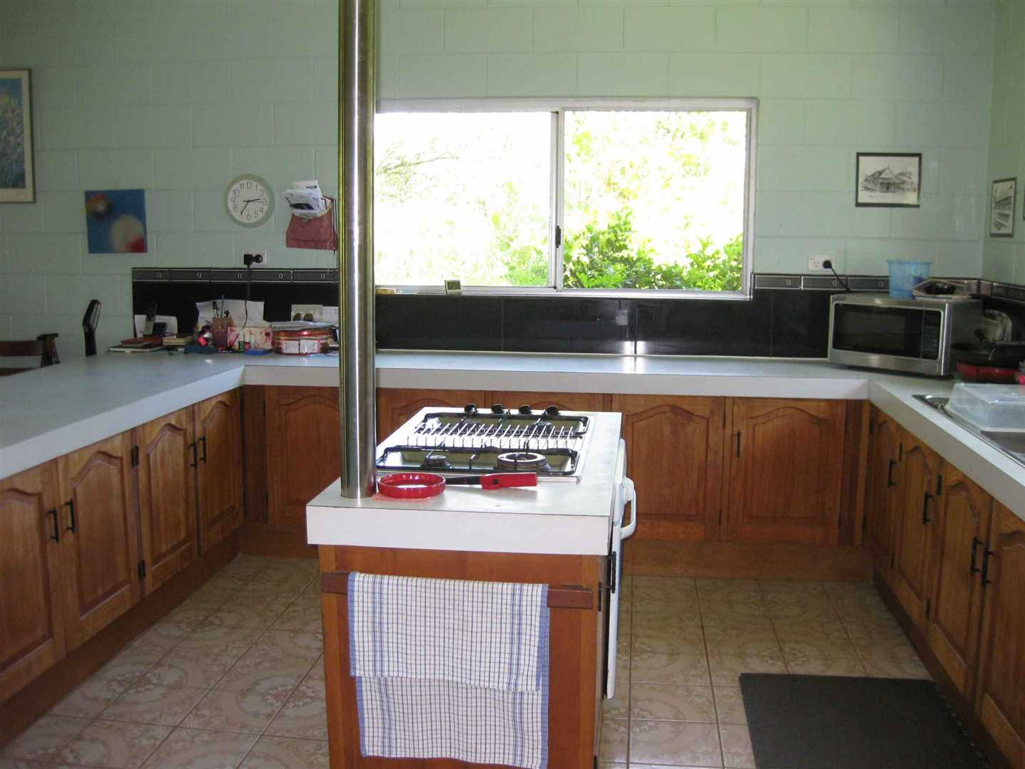 Inside view of part of home showing part of the kitchen