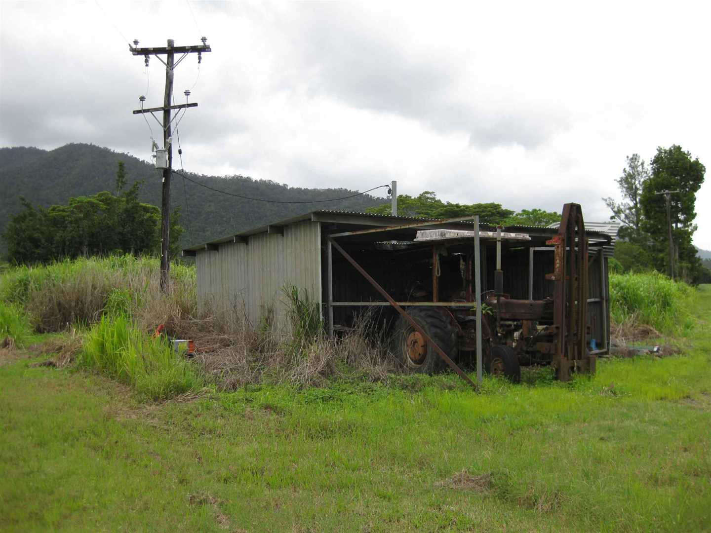 View of part of machinery shed (needs repairs)