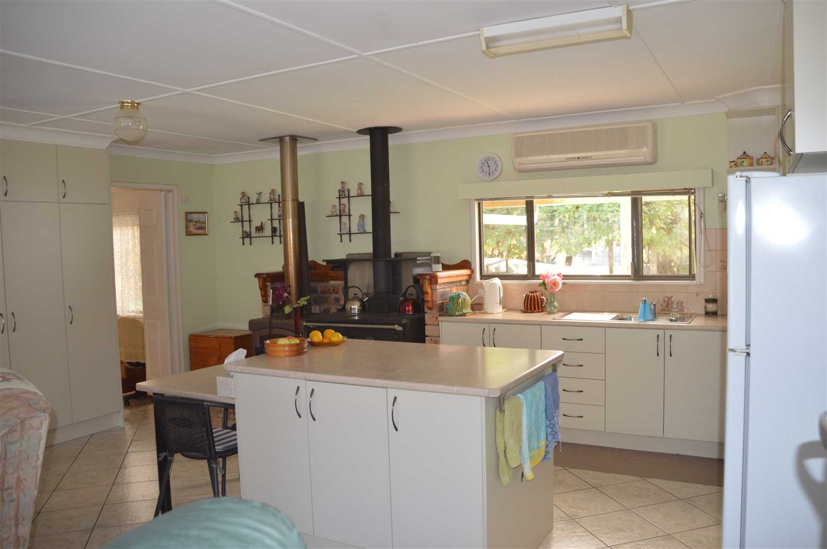 kitchen with slow combustion and wood stove